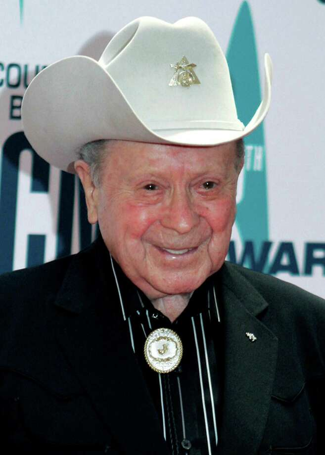 In this Nov. 6, 2006 file photo, Grand Ole Opry star Little Jimmy Dickens arrives at the 40th Annual CMA Awards in Nashville, Tenn. Dickens, a diminutive singer-songwriter who was the oldest cast member of the Grand Ole Opry, has died. Dickens, 94, died Friday, Jan. 2, 2015, at a Nashville-area hospital of cardiac arrest after suffering a stroke on Christmas Day, Opry spokeswoman Jessie Schmidt said. Photo: Chitose Suzuk, AP / AP