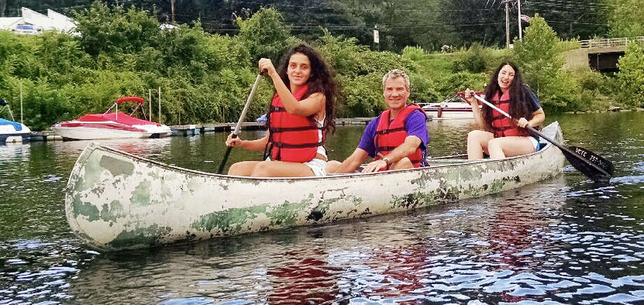 An international trio of campers at Jerulasem Peacebuilders team up for a canoe trip on the Connecticut River. From left are  Palestinian Leen Baransah, American Mike Pardee and Israeli Inbar Navon. Photo: Fairfield Citizen/Contributed / Fairfield Citizen