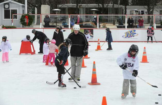 Children and instructors take to the ice during a event designed to provide kids ages 4 to 9 a free experience to try youth hockey at the Empire State Plaza ice rink on Saturday Jan. 3, 2015 in Albany, N.Y. (Michael P. Farrell/Times Union) Photo: Michael P. Farrell / 00029990A