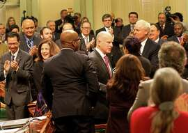 Members of the Legislature stand and applaud as Gov. Jerry Brown walks onto the Assembly floor with wife Anne Gust Brown.