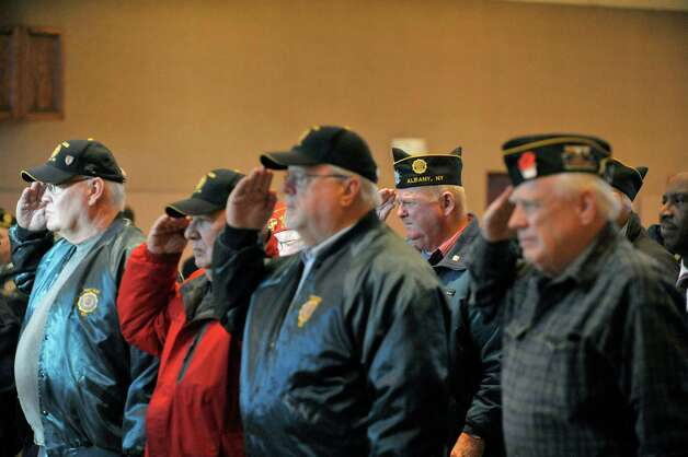 Veterans salute during the playing of taps at an event to honor veteran Joseph Persico, at the American Legion Joseph E. Zaloga Post 1520 on Monday, Jan. 5, 2015, in Albany, N.Y.  Persico was this month's Albany County Honor-a-Vet recipient.  Persico served in the US Navy.   (Paul Buckowski / Times Union) Photo: Paul Buckowski / 00030066A