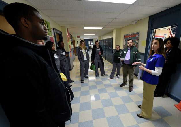 Members of the Siena Men's and Women's basketball team visit the North Albany Academy Monday morning, Jan. 5, 2015, in Albany, N.Y., to teach Capital Region students the importance of hard work and commitment. The appearance was part of the annual Siena Athletic Blue Shield of Northeastern New York Saints in the Community Program.  (Skip Dickstein/Times Union) Photo: SKIP DICKSTEIN / 00030064A