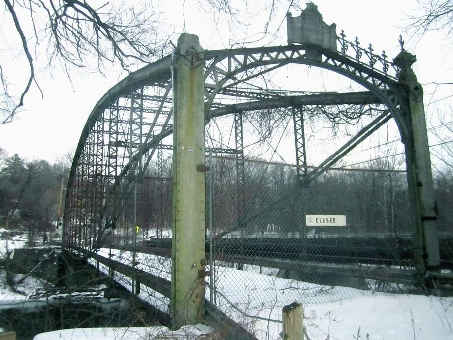 New Milford has secured a $15,000 grant to assess whether the long-disused Boardman Bridge can be renovated to permit foot and bike traffic. The bridge, which has spanned the Housatonic River since 1888, is one of the original metal-work bridges in New Milford. Photo: Norm Cummings / The News-Times