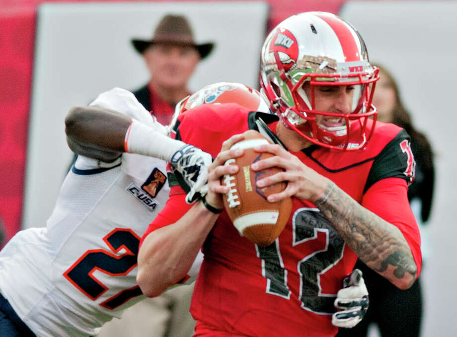 Western Kentucky Hilltoppers quarterback Brandon Doughty (12) is sacked by UTEP Miners defensive back Devin Cockrell (27) during the Hilltoppers' 35-27 victory over UTEP in the homecoming NCAA college football game at Houchens Industries-L.T. Smith Stadium on Saturday, Nov. 8, 2014, in Bowling Green, Ky. (AP Photo/Daily News, Austin Anthony) Photo: Austin Anthony, MBO / Daily News
