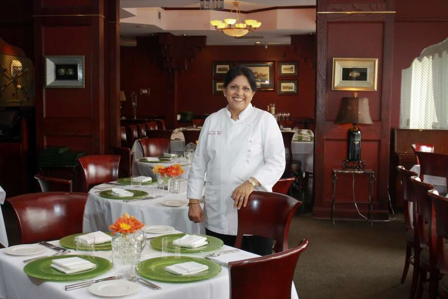 Kiran Verma, executive chef and owner of Kiran's, selected a 2011 Alexana Revana Vineyard Pinot Noir as her wine of choice. (Photo: Gary Fountain) Photo: Gary Fountain, For The Chronicle
