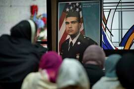 A photograph of Parminder Singh Shergill is displayed near his body during the funeral services for him at Cherokee Memorial Park in Lodi in February.