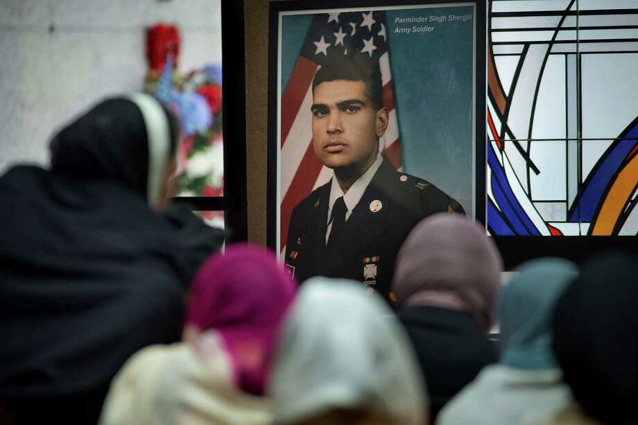 A photograph of Parminder Singh Shergill is displayed near his body during the funeral services for him at Cherokee Memorial Park in Lodi in February. Photo: Randall Benton / Rbenton@sacbee.com / ONLINE_CHECK