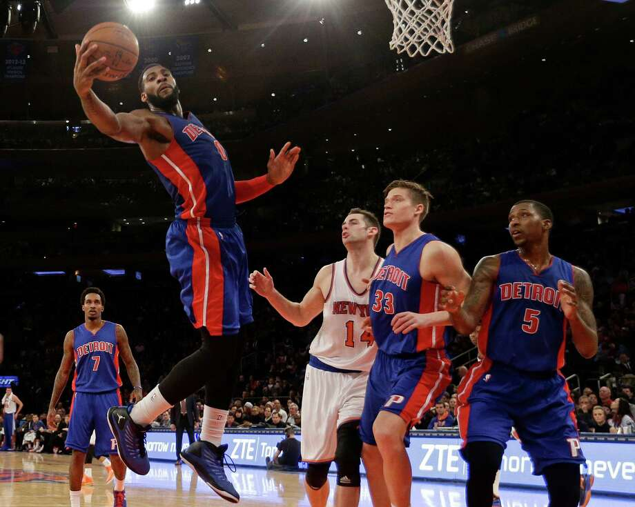 Detroit Pistons' Andre Drummond rebounds in front of the New York Knicks' Jason Smith (14) and teammates Jonas Jerebko (33) and Kentavious Caldwell-Pope (5) during the second half on Jan. 2, 2015, in New York. The Pistons won the game 97-81. Photo: Frank Franklin II /Associated Press / AP