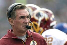 FILE - In this Nov. 17, 2013 file photo, Washington Redskins head coach Mike Shanahan watches the action during the first half of an NFL football game against the Philadelphia Eagles in Philadelphia. Add Mike Shanahan to the list of Buffalo Bills coaching candidates. Team officials, including owners Terry and Kim Pegula, interviewed the two-time Super Bowl-winning coach in San Francisco on Sunday, a person familiar with the search process told The Associated Press on Monday, jan. 5, 2015. The person spoke on the condition of anonymity because the Bills have not released details of their search to replace Doug Marrone, who abruptly stepped down last week. (AP Photo/Matt Rourke/File)