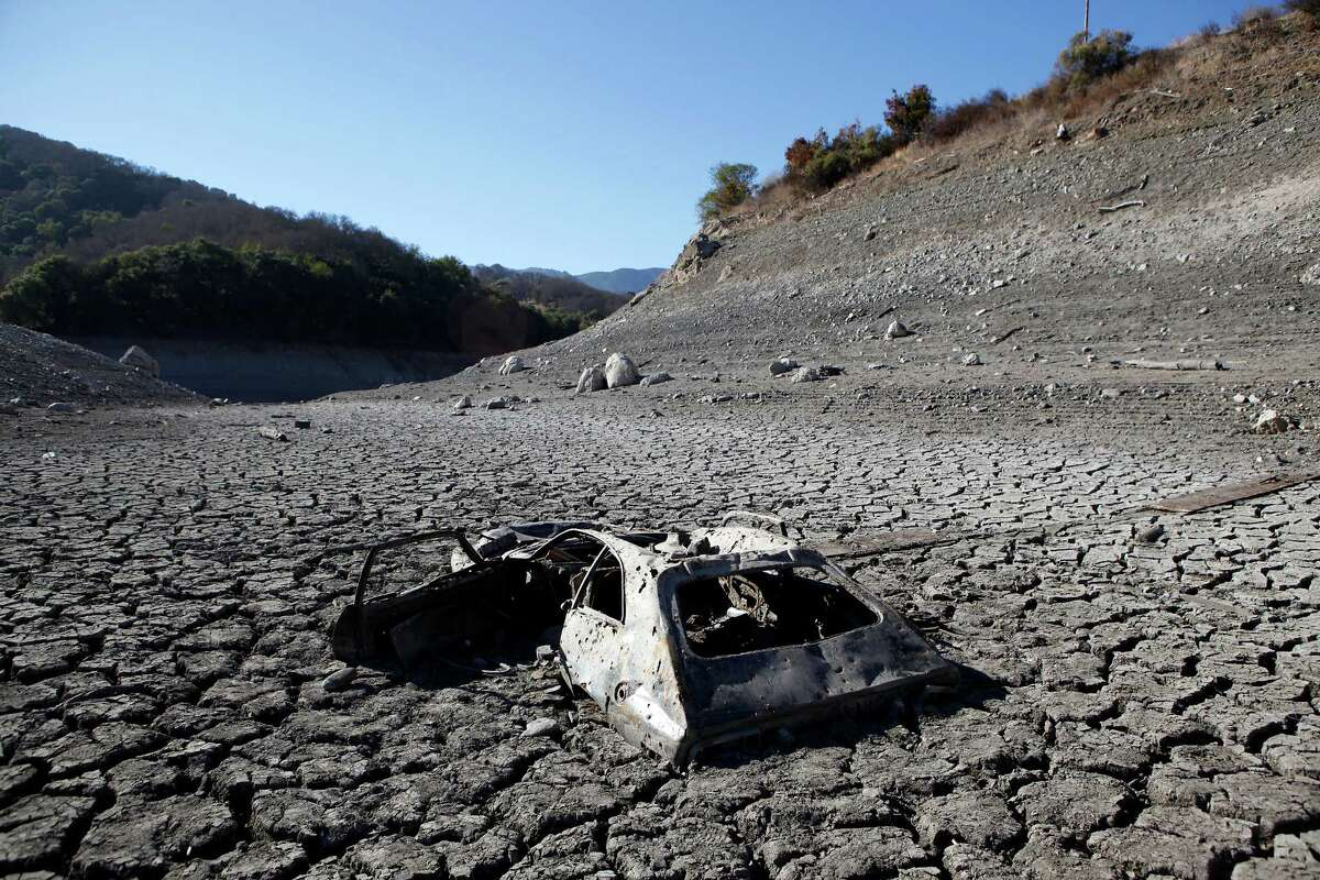 Due to the ongoing drought, receding waters at the Almaden Reservoir have revealed a car that was illegally dumped years ago and is now stuck in the lake bed, in San Jose, CA, Thursday, January 16, 2014.