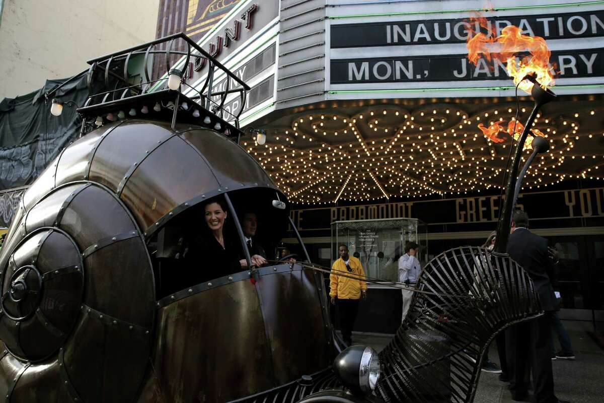 Libby Schaaf and her family arrive at the Paramount Theatre in an art car for her inauguration as Oakland's 50th mayor.