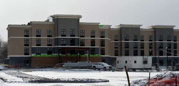 Exterior view of the new Homewood Suites hotel which is under construction adjacent to the Clifton Park Center Mall Monday morning, Jan. 5, 2015, in Clifton Park, N.Y.    (Skip Dickstein/Times Union) Photo: SKIP DICKSTEIN / 00030076A