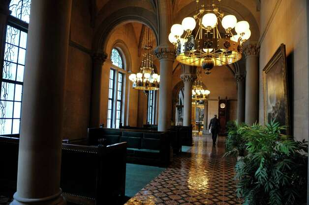 A man makes his way through the State Senate lobby at the Capitol on Monday, Jan. 5, 2015, in Albany, N.Y.  (Paul Buckowski / Times Union) Photo: Paul Buckowski / 00030082A