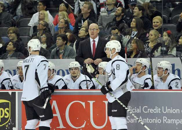 San Antonio Rampage head coach Tom Rowe instructs his players during the first period of an AHL hockey game against the Charlotte Checkers, Friday, Nov. 14, 2014, in San Antonio. San Antonio won 2-1 in overtime. (Darren Abate/AHL) Photo: Darren Abate / Darren Abate/DA Media, LLC