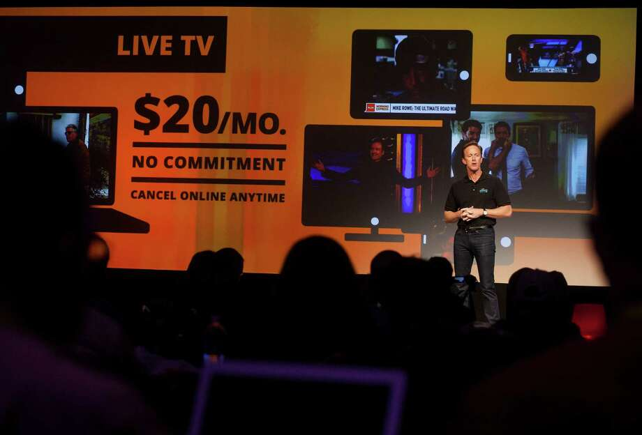 Roger Lynch, CEO for Sling TV LLC, speaks Monday at the 2015 CES in Las Vegas, where Dish Network Corp.unveiled the first major online television service from a cable or satellite company, a $20-a-month set of 12 channels that includes ESPN. Photo: Michael Nagle /Bloomberg News / © 2015 Bloomberg Finance LP