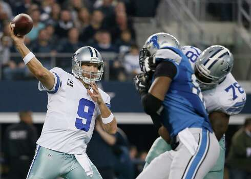 The Cowboys' Tony Romo throws a pass during the first half against the Detroit Lions. Photo: Tony Gutierrez /Associated Press / AP
