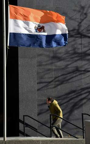High winds keep the flag straight out in downtown Monday morning Jan. 5, 2015 in Albany, N.Y.     (Skip Dickstein/Times Union) Photo: SKIP DICKSTEIN