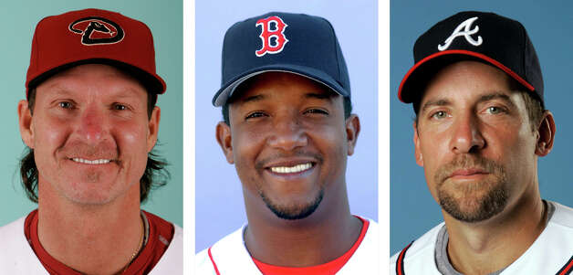 FILE - From left are Arizona Diamondbacks' Randy Johnson in 2008, Boston Red Sox' Pedro Martinez in 2003 and Atlanta Braves' John Smoltz in 2008. Randy Johnson, Pedro Martinez and John Smoltz are the leading newcomers on baseball's Hall of Fame ballot when voting is announced Tuesday, Jan. 6, 2014. (AP Photo/File) ORG XMIT: NY152 Photo: Uncredited / AP