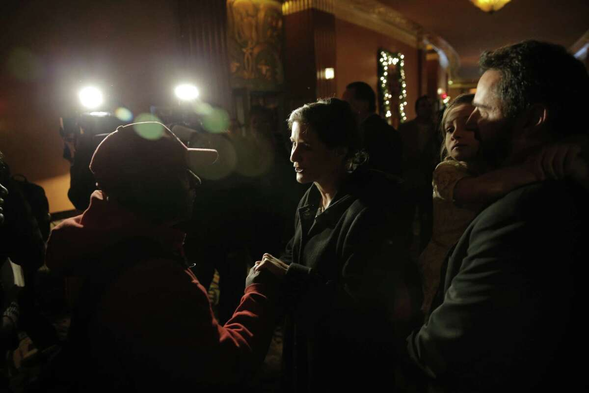 Oakland Mayor-elect Libby Schaaf is greeted by a supporter as she arrives with her family at the Paramount Theater in Oakland, Calif., for her inauguration on Monday, January 5, 2015.