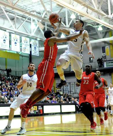 UAlbany's Wheeler Baker drives to the basket during their college men's basketball game against NJIT at the SEFCU Arena on Wednesday Nov. 19, 2014 in Albany, N.Y. (Michael P. Farrell/Times Union) Photo: Michael P. Farrell / 00029534A