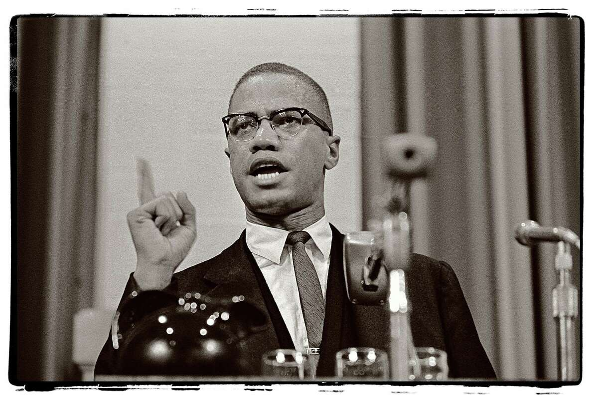 The late Post newspaper photographer Ed Brinsko is being remembered with an exhibition of his images at McLevy Hall in Bridgeport through Jan. 31. Above is a Brinsko photo of civil rights leader Malcolm X, who was assasinated in 1965.
