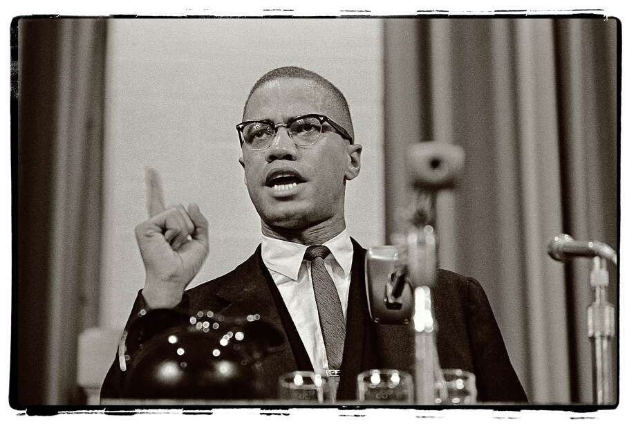 The late Post newspaper photographer Ed Brinsko is being remembered with an exhibition of his images at McLevy Hall in Bridgeport through Jan. 31. Above is a Brinsko photo of civil rights leader Malcolm X, who was assasinated in 1965. Photo: Contributed Photo / Connecticut Post Contributed
