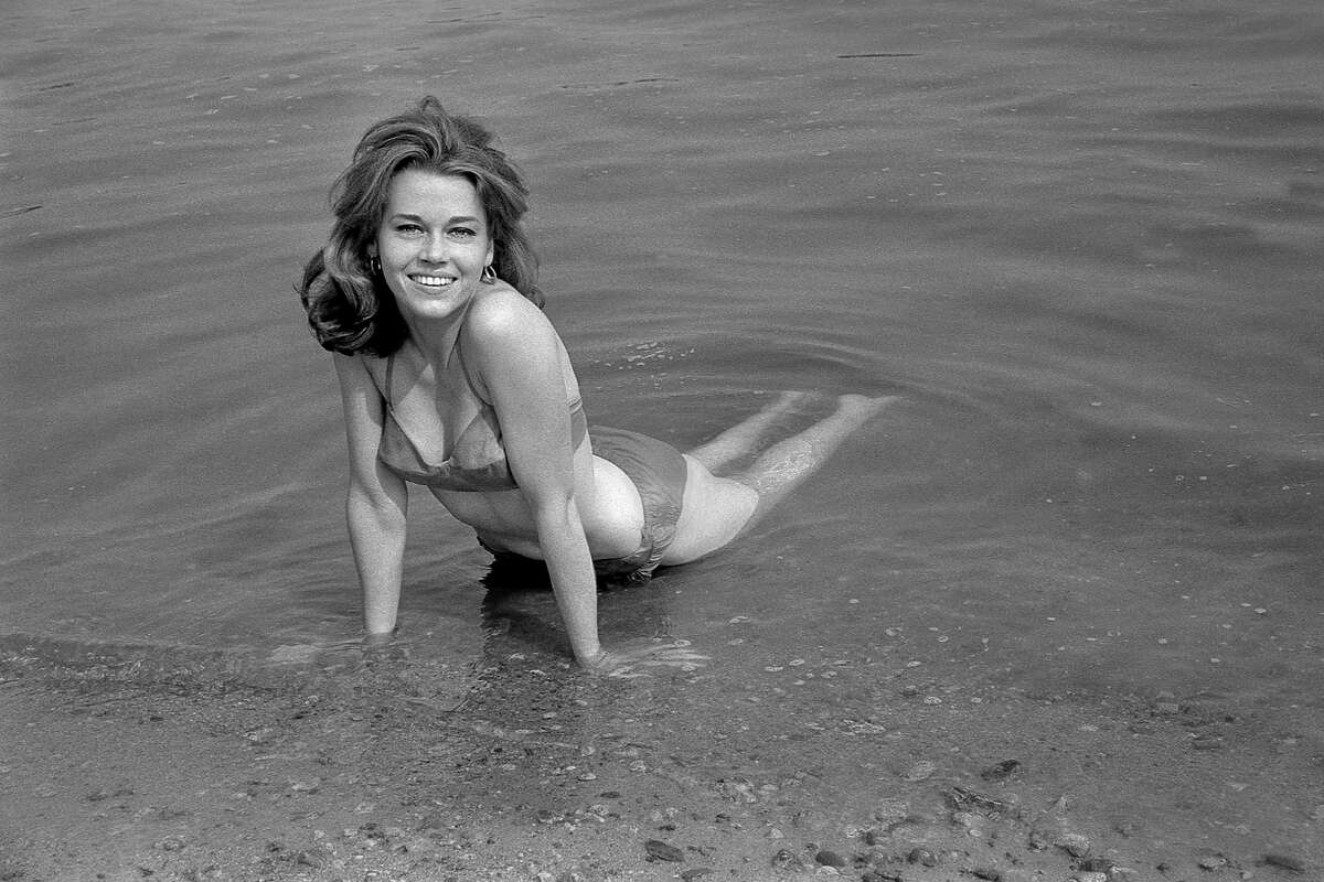 The late Post newspaper photographer Ed Brinsko is being remembered with an exhibition of his images at McLevy Hall in Bridgeport through Jan. 31. Above is a vintage Brinsko photo of actress Jane Fonda at a local beach.