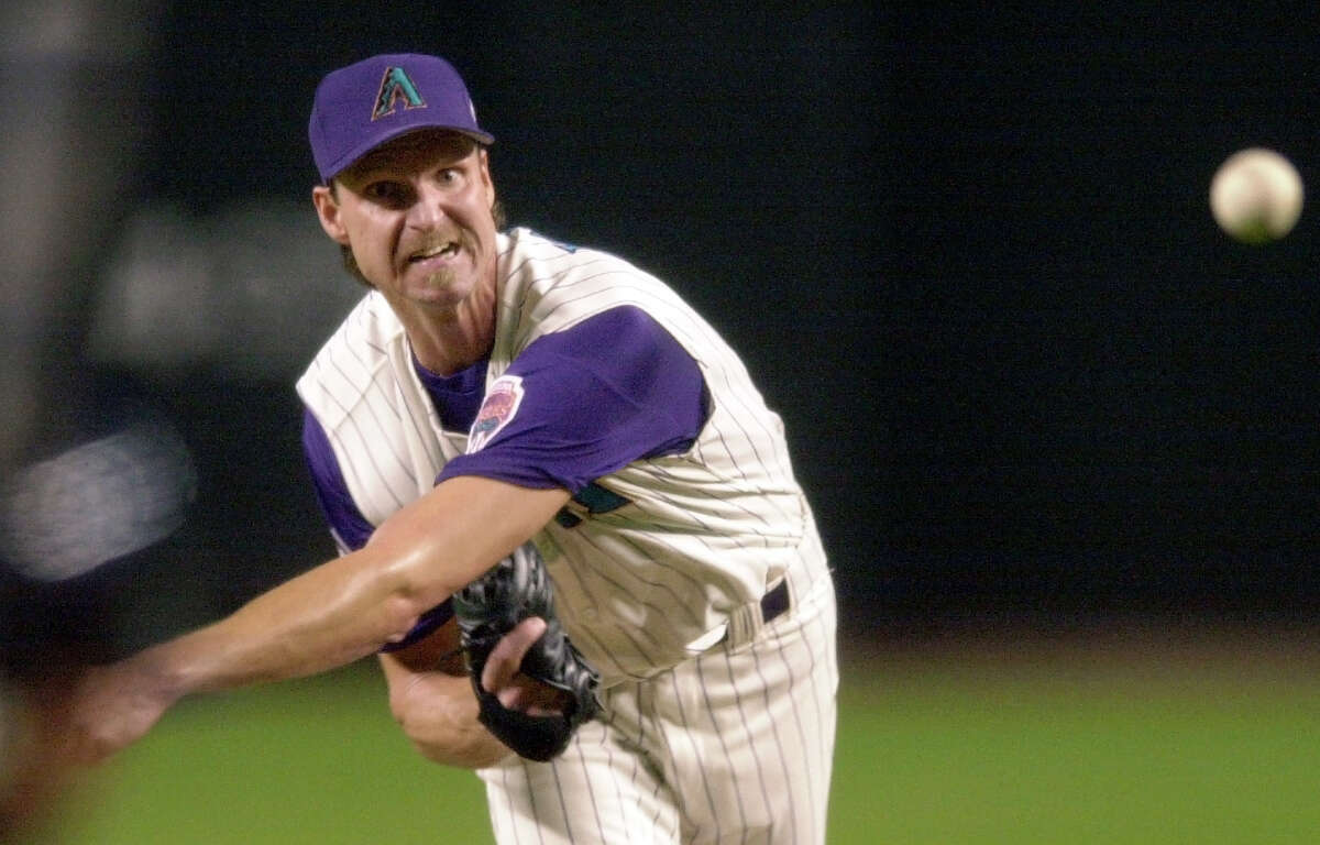 FILE - In this Nov. 1, 2001, file photo, Arizona Diamondbacks pitcher Randy Johnson throws against the New York Yankees in the first inning of Game 6 of the World Series at Bank One Ballpark in Phoenix. With a menacing fastball and devastating slider,