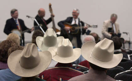 47a8cfe0adc66 Houston s The Bluegrass Solution performs during Cowboy Church at the  Houston Livestock Show and Rodeo Sunday