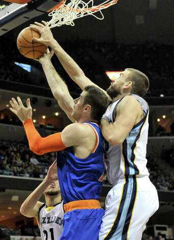 Memphis Grizzlies center Marc Gasol, right, blocks a shot by New York Knicks center Jason Smith in the first half of an NBA basketball game Monday, Jan. 5, 2015, in Memphis, Tenn. (AP Photo/Brandon Dill) ORG XMIT: TNBD108 Photo: Brandon Dill / FR171250 AP