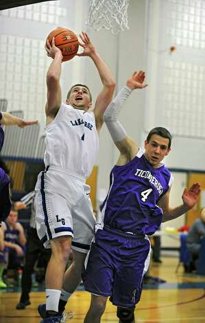 Lake George's Joel Wincowski drives to the basket to make a career point total of 2,000 during a basketball game against Ticonderoga on Monday, Jan. 5, 2015 in Lake George, N.Y. Joel was fouled on this important score and made his free throw also.  (Lori Van Buren / Times Union) Photo: Lori Van Buren / 00030073A