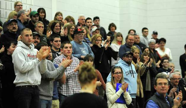 Fans clap after Lake George's Joel Wincowski makes a career point total of 2,000 during a basketball game against Ticonderoga on Monday, Jan. 5, 2015 in Lake George, N.Y. (Lori Van Buren / Times Union) Photo: Lori Van Buren / 00030073A