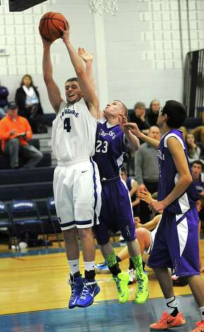 Lake George's Joel Wincowski snags a rebound during a basketball game against Ticonderoga on Monday, Jan. 5, 2015 in Lake George, N.Y. Joel reached a career point total of 2,000 within a couple minutes of the game.  (Lori Van Buren / Times Union) Photo: Lori Van Buren / 00030073A