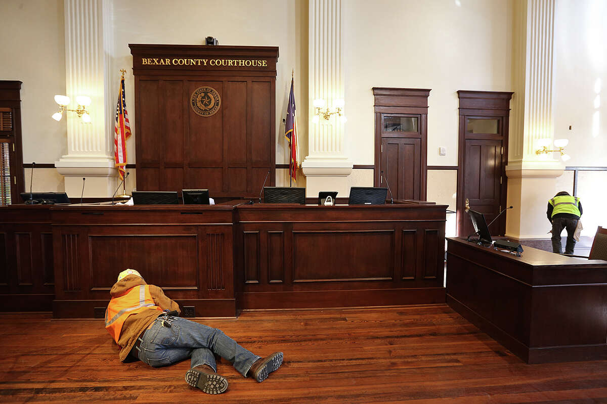 Work continues at the Bexar County Courthouse double-height courtroom, Monday, Jan. 5, 2015. The courtroom, on the second floor of the courthouse, is being renovated to its 1890's look and is nearly completed. The Bexar County commissioners will use the courtroom for their swearing-in ceremony on Tuesday.
