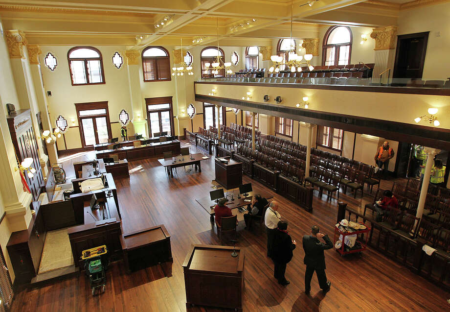 Work continues at the Bexar County Courthouse double-height courtroom, Monday, Jan. 5, 2015. The courtroom, on the second floor of the courthouse, is being renovated to its 1890's look and is nearly completed. The Bexar County commissioners will use the courtroom for their swearing-in ceremony on Tuesday. Photo: JERRY LARA, San Antonio Express-News / © 2015 San Antonio Express-News