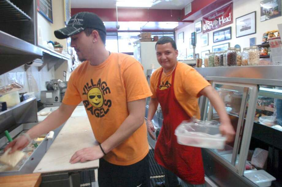Douglas LeDuc, from Norwalk, left and Edvin Rivera, from Stamford, working for VIllage Bagels, speaks about their thoughts of the Winter Olympics, on Sunday, February 28, 2010. Photo: Helen Neafsey / Greenwich Time