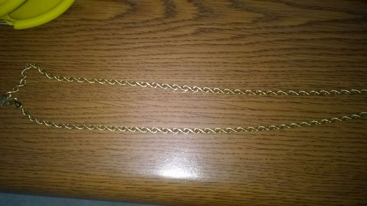 Theresa Green Mireles, a 57-year-old Corpus Christi woman, could see up to two years in prison for allegedly stealing a 14-karat gold necklace (pictured) from the body of Kenneth Grimes during an open wake on Dec. 17 at the Charlie Marshal Funeral Home in Port Aransas. Grimes died Dec. 15 from complications from bone cancer.