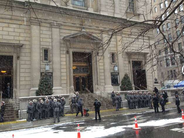 Amid falling snow, State Police line up outside St. Ignatius Loyola Church in Manhattan Tuesday for the funeral of the late Gov. Mario M. Cuomo. (Skip Dickstein / Times Union)