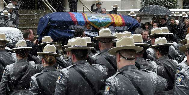 Wrapped with the state flag, former governor Mario Cuomo's casket is carried into St. Ignatius Loyola Church for funeral services Tuesday morning, Jan. 6, 2015, in New York City, N.Y.  (Skip Dickstein/Times Union) Photo: SKIP DICKSTEIN / 00030083A