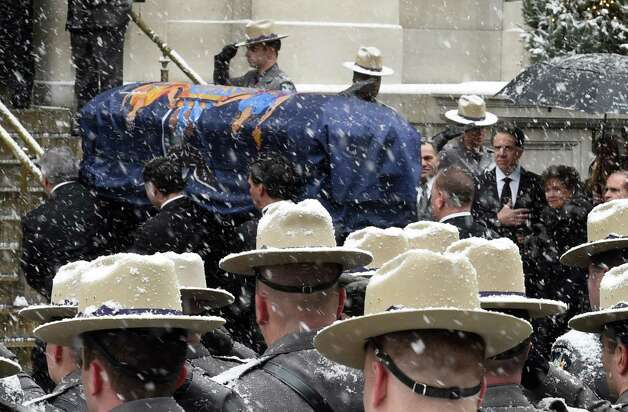 Governor Andrew Cuomo, second from right, stands with his mother Matilda Cuomo, right, as the coffin carrying his father, former Governor Mario M. Cuomo, arrives at the front door of St. Ignatius Loyola Church for funeral services Tuesday morning, Jan. 6, 2015,  in New York City, N.Y. (Skip Dickstein/Times Union) Photo: SKIP DICKSTEIN / 00030083A