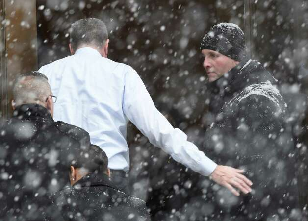New York City Mayor Bill de Blasio pats a NYC policeman on the arm as he arrives for the funeral of former Governor Mario M. Cuomo Tuesday morning, Jan. 6, 2015, at St. Ignatius Loyola Church in New York City, N.Y.  (Skip Dickstein/Times Union) Photo: SKIP DICKSTEIN / 00030083A