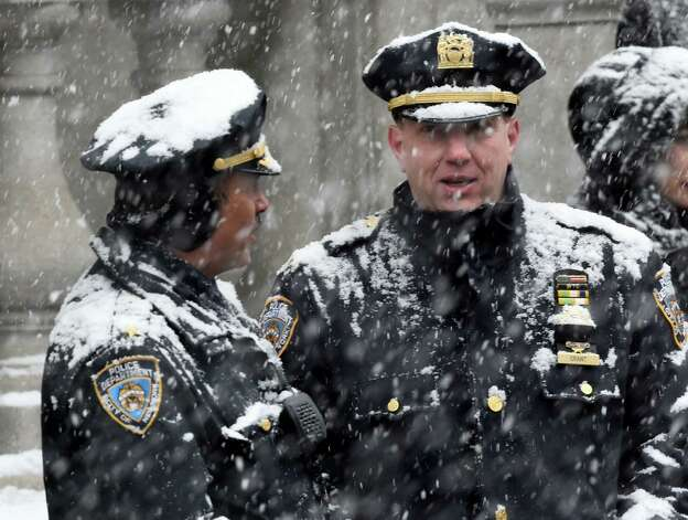 New York City cops are covered with snow as they wait for the funeral of former Governor Mario M. Cuomo Tuesday morning, Jan. 6, 2015, at St. Ignatius Loyola Church in New York City, N.Y.  (Skip Dickstein/Times Union) Photo: SKIP DICKSTEIN / 00030083A