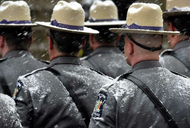 Members of the New York State Police are covered with snow at the funeral of former Gov. Mario M. Cuomo Tuesday morning Jan. 6, 2015, at St. Ignatius Loyola Church in New York City, N.Y.  (Skip Dickstein/Times Union) Photo: SKIP DICKSTEIN / 00030083A