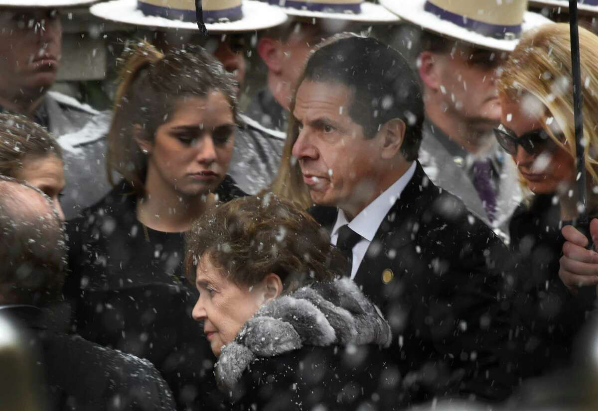 Gov. Andrew Cuomo accompanies his mother, Matilda Cuomo, and girlfriend, Sandra Lee, right as they arrive for the funeral of former Governor Mario M. Cuomo Tuesday morning, Jan. 6, 2015, at St. Ignatius Loyola Church in New York City, N.Y. (Skip Dickstein/Times Union)