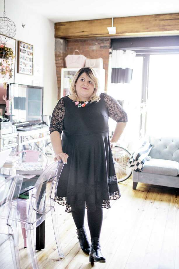 Nicolette Mason, a plus-size fashion blogger, at her apartment in New York, Dec. 7, 2014. A new crop of online boutiques, retailers and designers is trying to make plus-size styles more fashion forward. (Ramsay de Give/The New York Times) Photo: RAMSAY DE GIVE, STR / NYTNS