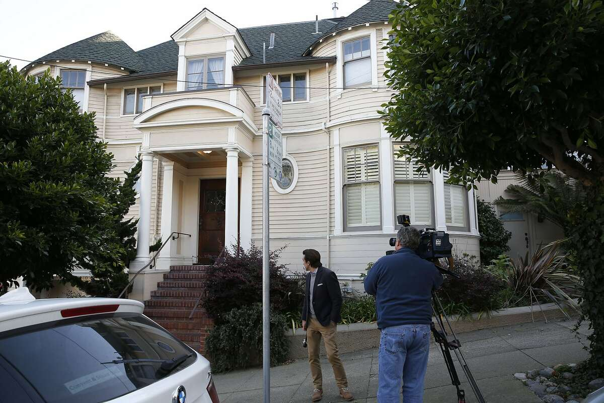 Local news crews check out the scene at Steiner and Broadway Streets on Tuesday Jan. 06, 2015 in San Francisco, Calif, after a suspected arson set small fires to the house used in the Robin Williams movie Mrs. Doubtfire.