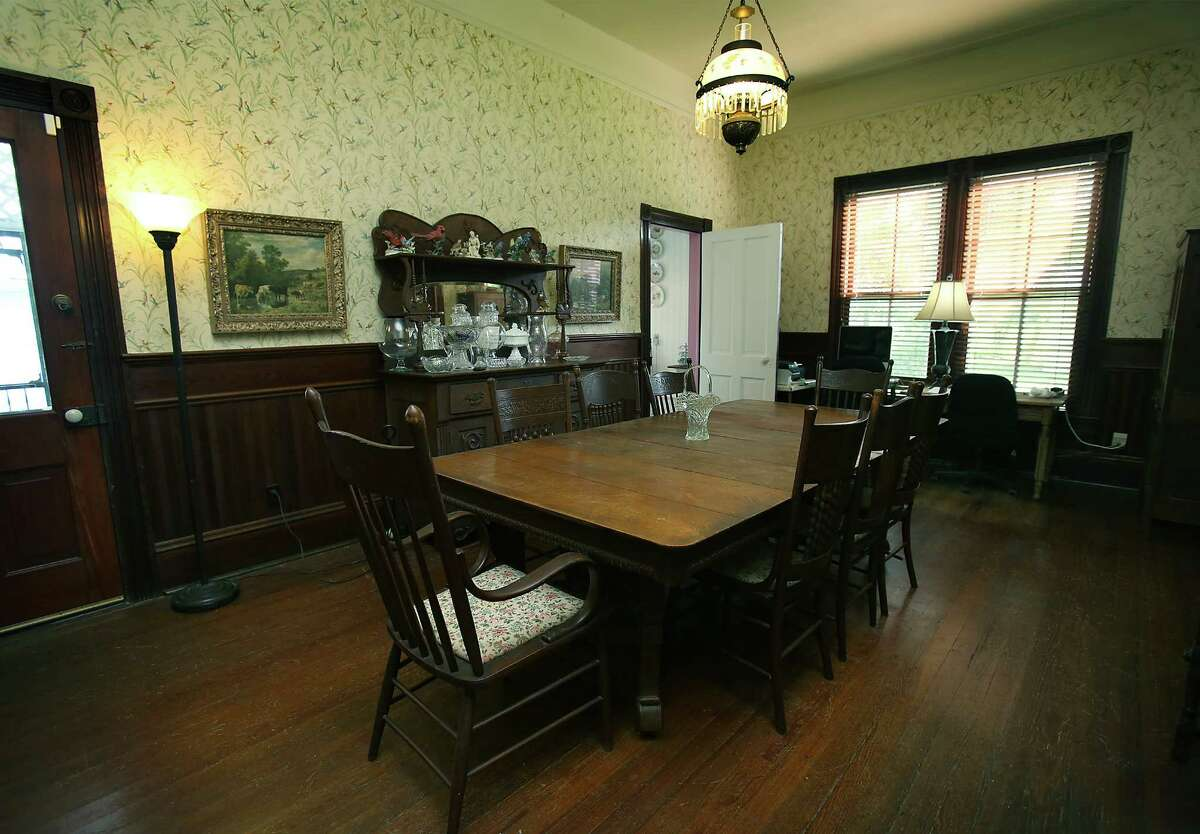 The dining table in the historic home of Mary Jane and Wayne Windle in Seguin has a history of its own, having served as an operating table when Wayne Windle's great-great-grandfather suffered a badly broken leg.