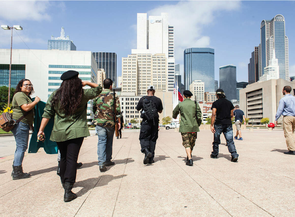 The Huey P. Newton Gun Club marches on downtown Dallas, October 2014.