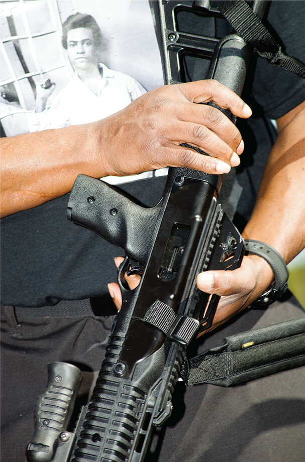 Darren X and his AR-15. Photo: Photos By Bobby Scheidemann For VICE