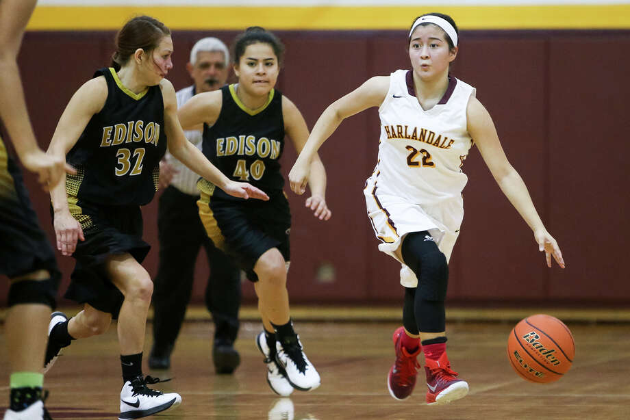 Harlandale's Justyne Perez (from right) brings the ball upcourt past Edison's Victoria Rodriguez and Jasmin Chapa during their game at Harlandale on Tuesday, Dec. 30, 2014.  The Lady Indians beat Edison 50-41.  MARVIN PFEIFFER/ mpfeiffer@express-news.net Photo: Marvin Pfeiffer, Staff / San Antonio Express-News / Express-News 2014